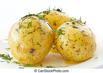 young boiled potatoes with dill in oil