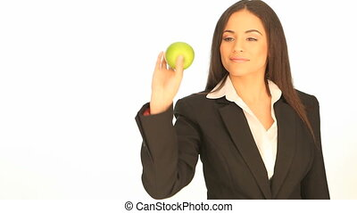 Businesswoman holding a fresh apple