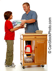Domestic Laundry Team - A father handing his daughter folded...