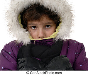 Freezing - Close-up of a preteen girl bundled in winter...