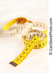 Measuring tape - Close up of a yellow measuring tape