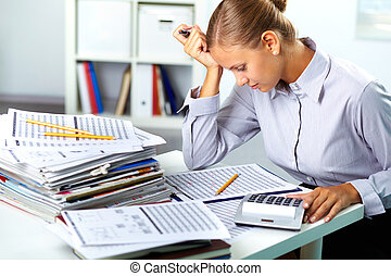 Accountant at work - Portrait of a young businesswoman...