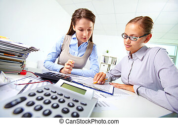 Busy females - Portrait of two businesswomen working with...