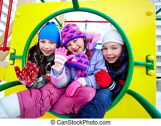 Cute friends - Happy kids in winterwear looking at camera...