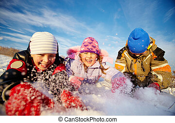 Enjoying winter - Joyful kids in winterwear having happy...