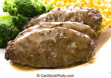 salisbury steak dinner - salisbury steak topped with gravy...