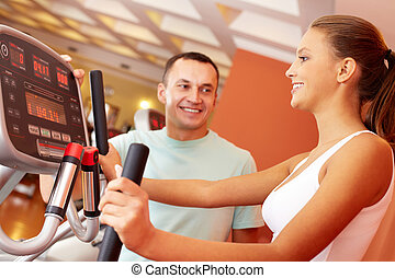 Girl in gym - Portrait of pretty girl training in gym with...