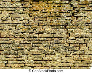 Old, ragged brick wall texture for background