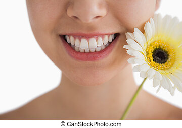 Smiling woman with a flower - Close-up of woman having a...