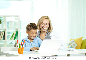 Education online - Portrait of pretty tutor and her pupil...