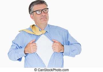 Serious man with glasses is pulling his shirt with his hands...