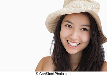 Smiling woman with a straw hat