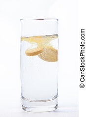 Vitamin tablet dissolving in water - Vitamin tablet...