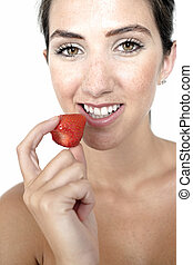 Woman eating fresh strawberry