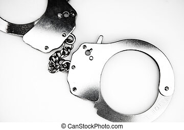 Handcuffs lying  - Handcuffs against white background