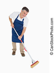 Happy man mopping floor - Happy man in blue apron mopping...