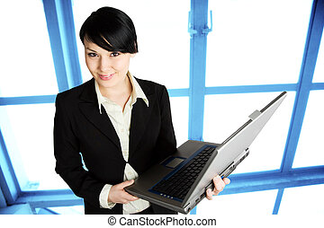 Businesswoman with laptop - A shot of a businesswoman...
