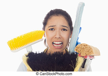 Very stressed woman with cleaning tools - Very stressed...