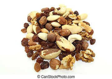Nut-fruit mixture - various nuts and raisins on white...