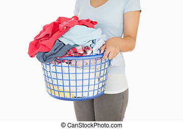 Woman holding a laundry basket - Woman holding an...
