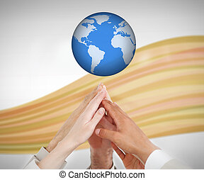 People reaching hands to the globe - People reaching hands...