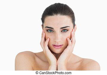 Woman touching her cheek - Female beauty touching her cheek
