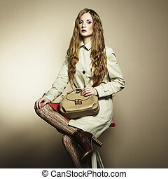 Portrait of a beautiful young woman with a handbag Fashion...