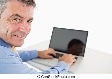 Happy man working with laptop