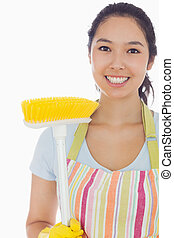 Smiling woman with broom