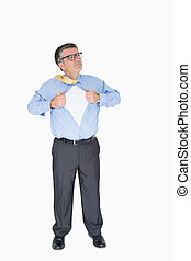 Concentrated man with glasses is pulling his shirt with his...