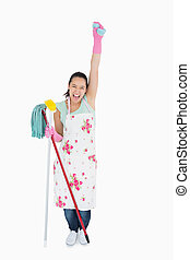 Woman holding a sponge in the air and shouting - Woman...