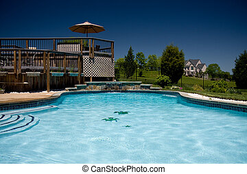 Water level view of pool and deck - View of a backyard...