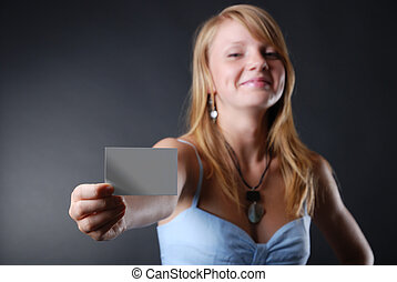 Young woman with a business card