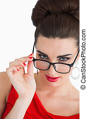 Woman wearing glasses and red dress