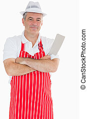 Butcher with arms crossed holding meat cleaver - Smiling...