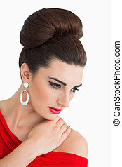 Woman looking down while wearing a red dress - Glamorous...