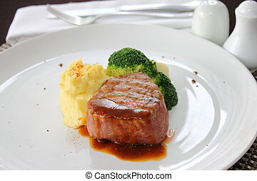 Tenderloin steak with sauce and boiled vegetables