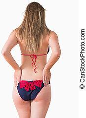 Woman at rear wearing bikini