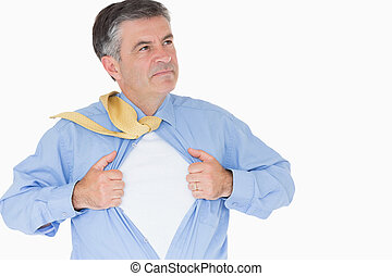 Serious man pulling his shirt with his hands like a...