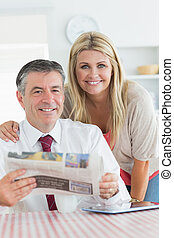 Smiling couple in the kitchen - Smiling couple with...