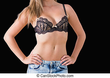 Woman wearing black bra - Close-up of woman wearing black...