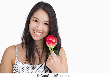 Smiling woman holding a rose - Smiling woman in polka dots...