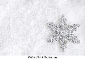 Christmas Snowflake on Snow - Winter background shot from...