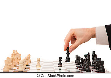 Hand moving a chessman - Hand moving a black chessman...