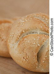 Close up kaiser roll - Close up of kaiser roll with sesame...