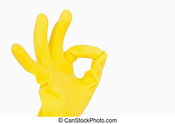 Hand in glove showing ok symbol - Hand in rubber glove...
