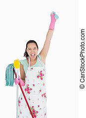 Shouting woman holding a sponge in the air - Shouting woman...