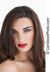 Woman with wavy hair and red lips on white background