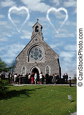 wedding day - people outside a church celebrating the...