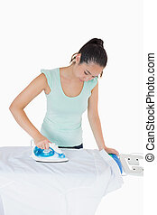 Woman ironing a shirt on a white background